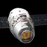 SpaceX Dragon spacecraft on black field image credit James Vaughan SpaceFlight Insider