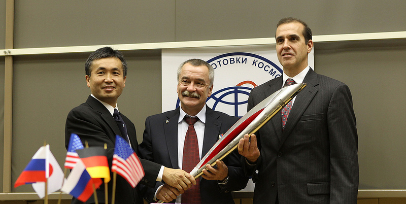 At the Gagarin Cosmonaut Training Center in Star City, Russia, Expedition 38 Flight Engineer Koichi Wakata of the Japan Aerospace Exploration Agency (left), Soyuz Commander Mikhail Tyurin (center) and NASA Flight Engineer Rick Mastracchio pose for pictures with a model of the Olympic torch. Photo credit: NASA