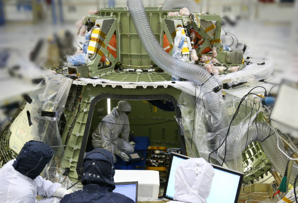 "NASA""s Orion spacecraft, the test article which will fly the Exploration Flight Test 1 next year, had its avionics installed and tested last week at Kennedy Space Center in Florida. Photo Credit: NASA"