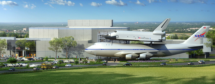 Artists rendering of replica shuttle Independence atop the NASA 905 shuttle-carrier aircraft. Image credit: Space Center Houston