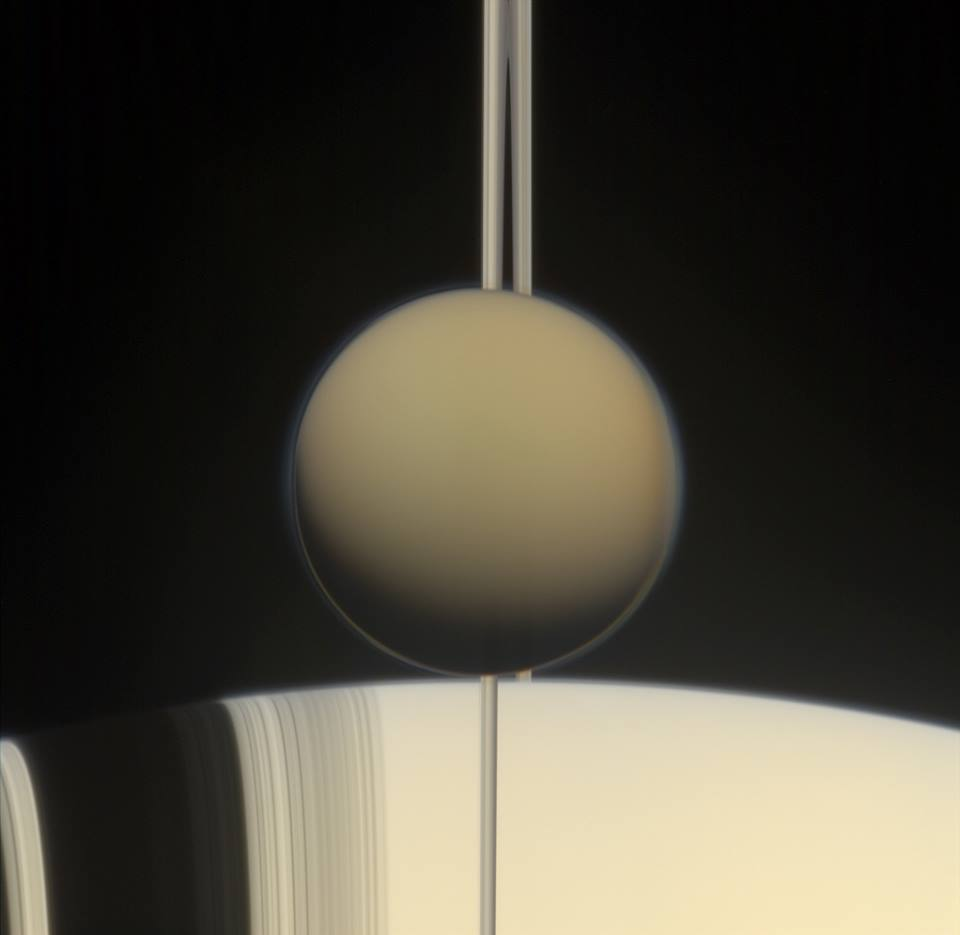 NASA's Cassini spacecraft has detected the chemical ingredients of one of mankind's most versatile materials in Titan, the smoggy moon of Saturn - plastic. Image Credit: NASA/JPL