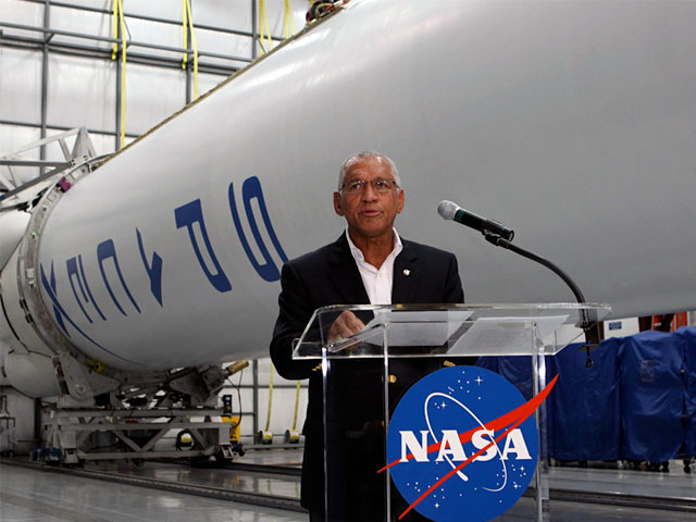 NASA Administrator hailed the conclusion of the agency's Commercial Orbital Transportation Services (COTS) program in a news conference at NASA's headquarters in Washington D.C. Photo Credit: SpaceX