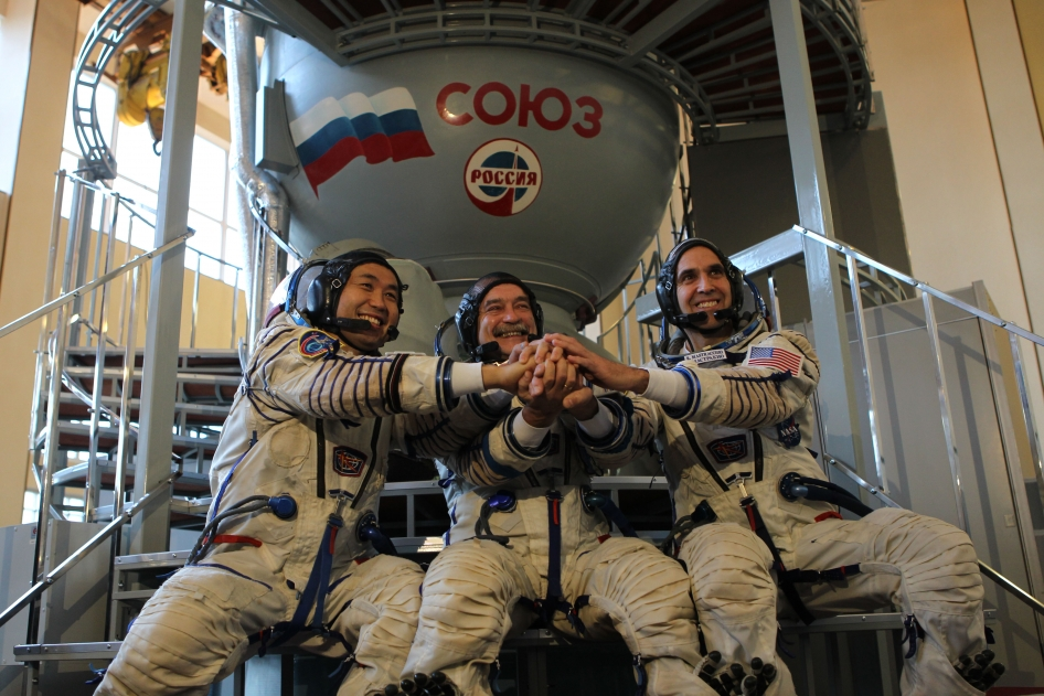 Expedition 38's Koichi Wakata of the Japanese Aerospace Exploration Agency (left), Soyuz Commander Mikhail Tyurin (center) and NASA astronaut Rick Mastracchio strike a pose during training. Photo Credit: NASA