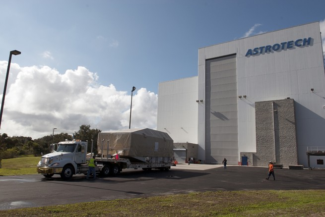 CAPE CANAVERAL, Fla. – A truck hauls NASA's TDRS-L satellite to the Astrotech facility in Titusville for launch processing. Photo credit: NASA/Charisse Nahser