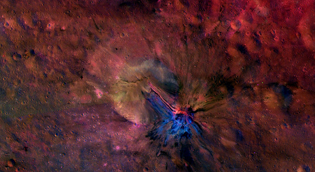 This colorful composite image from NASA's Dawn mission shows the flow of material inside and outside a crater called Aelia on the giant asteroid Vesta. The area is around 14 degrees south latitude. The images that went into this composite were obtained by Dawn's framing camera from September to October 2011. Image credit: NASA/JPL-Caltech/UCLAMPS/DLR/IDA