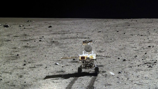 China's Youo rover drives accross the Lunar surface. Photo Credit: CNSA