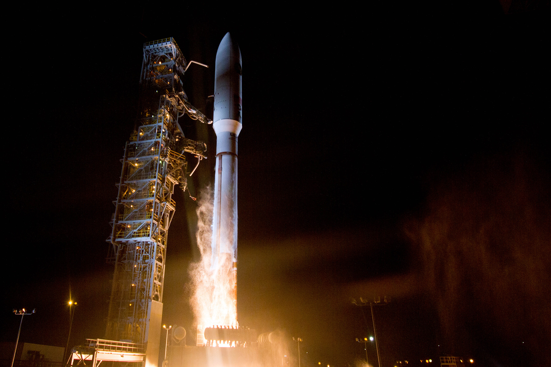 A United Launch Alliance Atlas V 502 rocket lifts off from Vandenberg Air Force Base's Space Launch Complex 3 in California with a classified payload for the National Reconnaissance Office. Launch occurred at 11:14 p.m. PST. Photo Credit: ULA