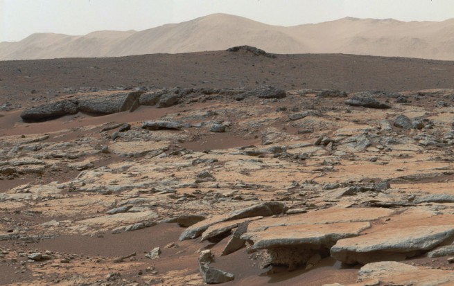 View from Yellowknife Bay in Gale crater, looking west-northwest. This area of sedimentary deposits is now known to be the former bottom of a freshwater lake. Photo Credit: NASA/JPL-Caltech
