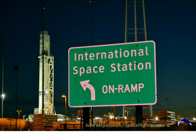 The Antares launch vehicle sits on the pad, the road sign pointing to the rocket's future sits on the right of frame. Photo Credit: Ivan Meyerovich / SpaceFlight Insider