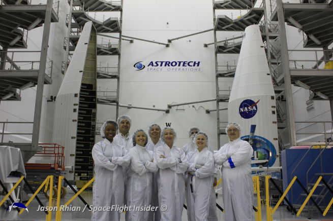 Members of NASA's Launch Services Program pose in front of TDRS-L's fairing at the Astrotech Facilities in Titusville, Florida. Photo Credit: Jason Rhian / SpaceFlight Insider