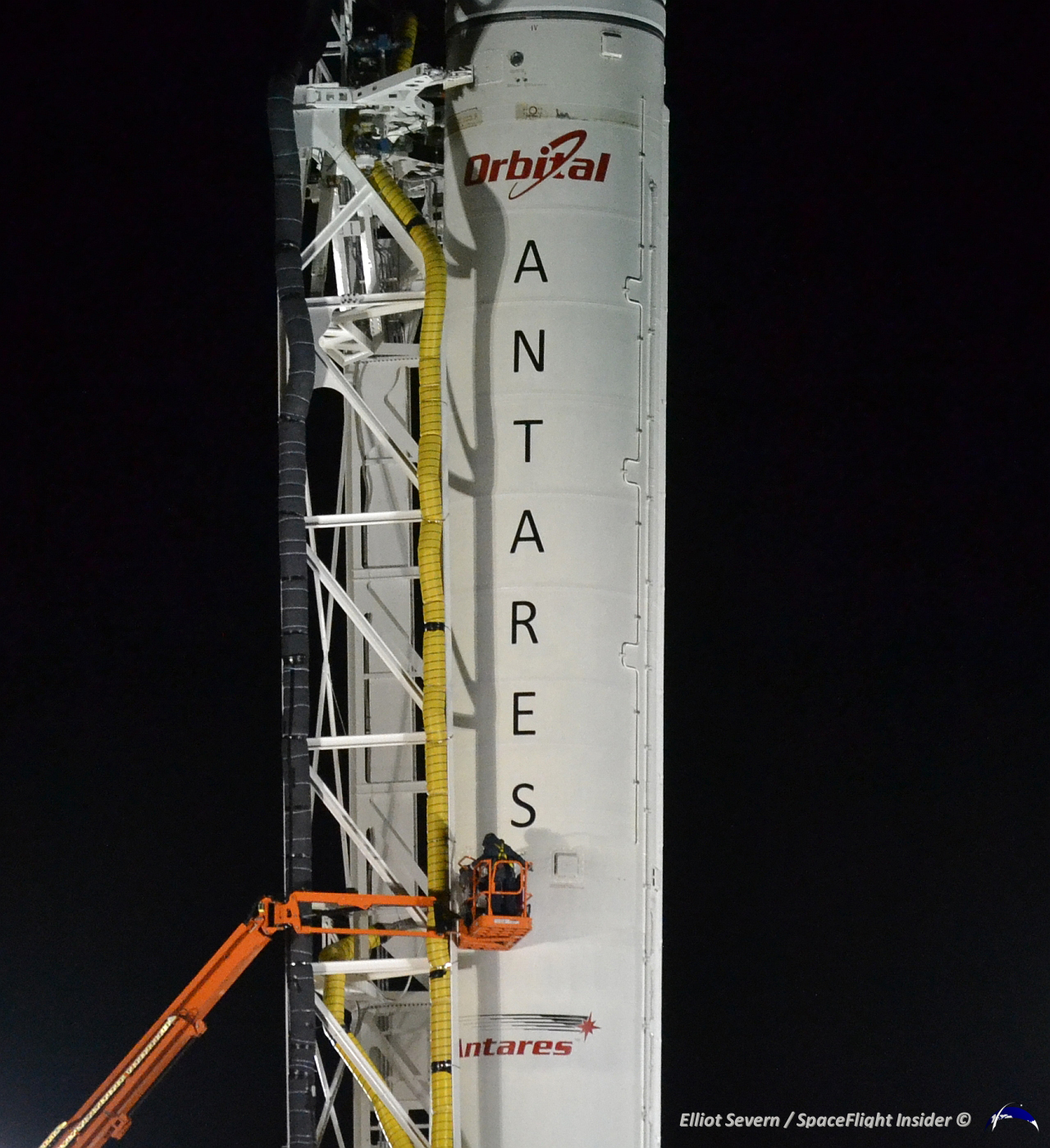 Workers preparing Antares for launch give a sense of scale. Photo Credit: Elliot Severn / SpaceFlight Insider