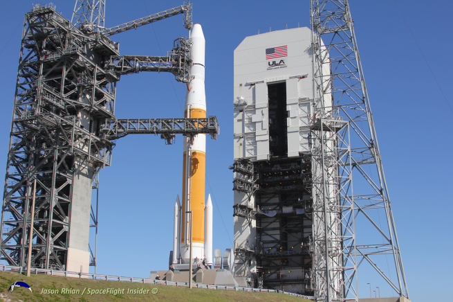 The Delta IV Medium + 4.2 is protected and worked on underneath what is known as the Mobile Service Tower. The day of launch, the building is moved back away from the rocket - the distance of a football field. Photo Credit: Jason Rhian / SpaceFlight Insider