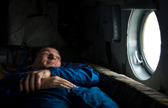 Expedition 38 Flight Engineer Mike Hopkins takes a break at the close of the Expedition 38 mission. Photo Credit: Bill Ingalls / NASA