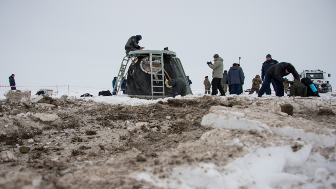 The descent module for the Soyuz TMA-10M sits on the Kazakh steppes after completing its mission. Photo Credit: Bill Ingalls / NASA