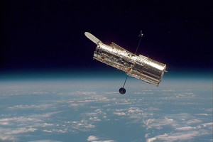 Hubble floats above the Earth in this image from 1997. Photo Credit: NASA / STScI.