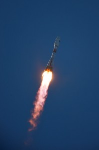 Against a deep blue sky, the Soyuz STA makes the journey out of Earth's gravity well. Photo Credit: ESA