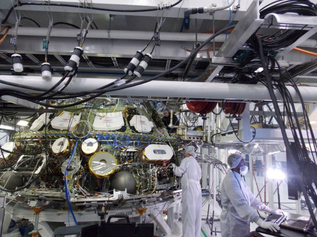 Engineers in the Operations and Checkout Building at NASA's Kennedy Space Center in Florida, perform avionics testing on the Orion spacecraft being prepared for its first trip to space later this year. Photo Credit:  Lockheed Martin