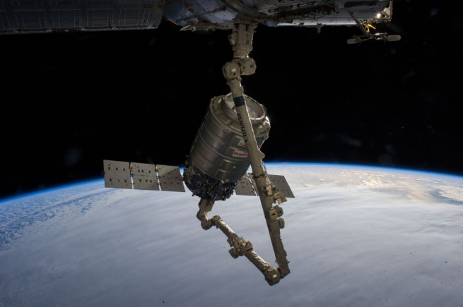 The Cygnus capsule and Canadarm2 during rendezvous and berthing operations on Jan. 12, 2014. Photo Credit: NASA