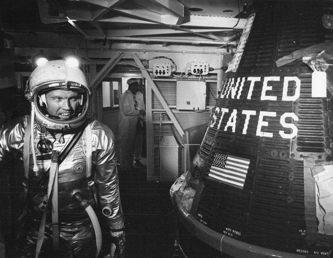Gordon Cooper in his Mercury pressure suit as he looks over to Faith 7, the spacecraft that will take him into space. Photo Credit: NASA