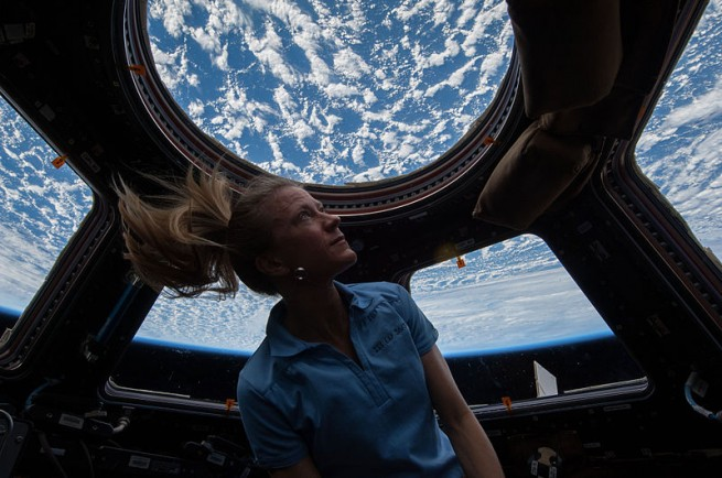 NASA astronaut Karen Nyberg, Expedition 37 flight engineer, enjoys the view of Earth from the windows in the Cupola of the International Space Station. Photo Credit: NASA