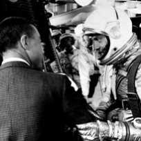 Alan Shepard speaks with Gus Grissom (on left, back to camera), prior to climbing aboard his Freedom 7 capsule for his Mercury-Redstone 3 mission on May 5, 1961. John Glenn (behind Shepard) waits to help strap Shepard into the spacecraft. Photo Credit: NASA