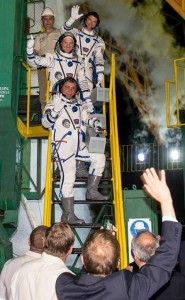 Expedition 40 crew wave their final goodbyes before boarding the Soyuz. Photo Credit: Joel Kowsky/NASA