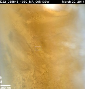 "The original Weathercam image from the Mars Color Imager (MARCI) camera showing the ""dark spot"" which turned out to be the new impact crater. Image Credit: NASA/JPL-Caltech/MSSS"