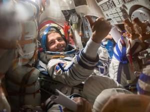 NASA astronaut Reid Wiseman, giving a thumbs up during launch preparations. Photo Credit: NASA