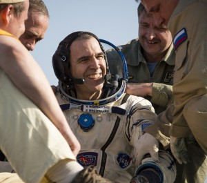 Expedition 39 Flight Engineer Rick Mastracchio of NASA is helped out of the Soyuz capsule shortly after landing. Photo Credit: NASA/Bill Ingalls posted on SpaceFlight Insider
