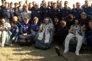 Expedition 39 crew resting after being extracted from their Soyuz capsule. Photo Credit: NASA TV