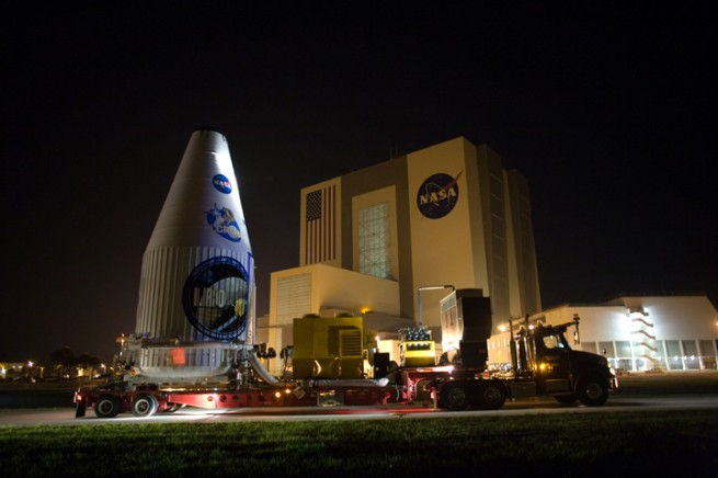 LRO, safely encapsulated in its payload fairing, wheels past NASA's Vehicle Assembly Building at Kennedy Space Center in Florida. Photo Credit: Dimitri Gerondidakis / NASA