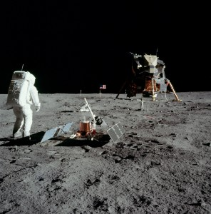 Buzz Aldrin sets up the passive seismograph, one of several experiments on the first lunar landing mission. Photo Credit: NASA