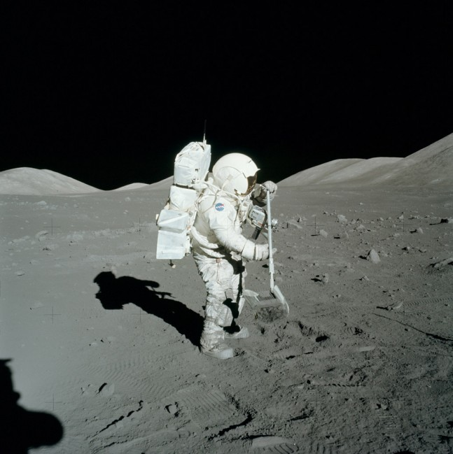 Astronaut Harrison Schmitt collecting moon rocks during the Apollo 17 mission, 1972. Photo Credit: NASA
