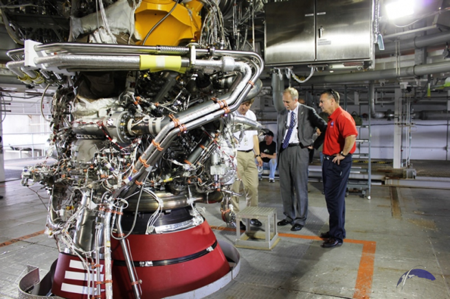 NASA's Associate Administrator Human Exploration and Operations William Gerstenmaier along with Stennis Space Center Director Richard Gilbrech review one of Aerojet Rocketdyne's J2-X engines. Photo Credit: Jason Rhian / SpaceFlight Insider