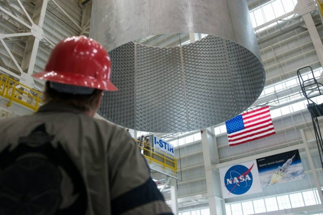 A barrel is lifted off the Vertical Weld Center (VWC) at NASA's Michoud Assembly Facility in New Orleans. Photo Credit: NASA/MAF