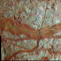 This colorized surface image of Europa was compiled from data collected by NASA's Galileo spacecraft. The blue-white regions indicate relatively pure water ice. Image Credit: NASA/JPL-Caltech/SETI Institute