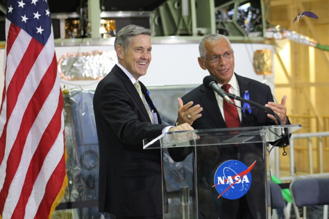 NASA Kennedy Space Center Director Robert Cabana (left) and NASA Administrator Charles Bolden share a laugh with the Expedition 40 crew during a live transmission from the ISS. The two former shuttle astronauts spoke with the crew about the importance of Armstrong's legacy. Photo Credit: Jason Rhian / SpaceFlight Insider