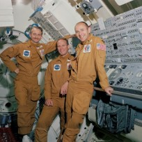 Pictured in the one-G trainer Multiple Docking Adapter (MDA) at JSC are L to R: scientist-astronaut Owen Garriott, science pilot; and astronauts Jack Lousma and Alan Bean, pilot and commander, respectively. Photo credit: NASA