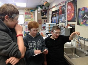 Seventh graders from Northland Preparatory Academy preparing their onion cell study. Photo Credit: SSEP