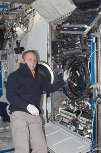 Astronaut Mike Fincke with the Combustion Integrated Rack facility in the Destiny module of the ISS. Photo Credit: NASA