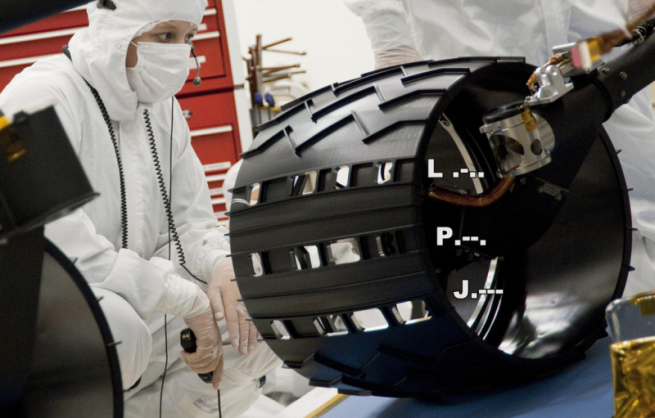 "The ""Morse Code"" pattern can be seen here. Each of the wheels measures some 20 inches (50 cm) in diameter. Photo Credit: NASA / JPL"