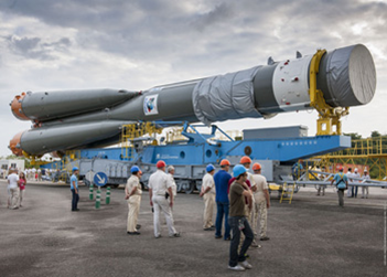 The Soyuz booster which will carry the two Galileo satellites to orbit is rolled out to the launch pad. Photo Credit: Arianespace