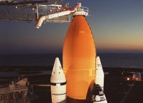 """The gaseous oxygen vent arm or """"beanie cap"""" at Kennedy Space Center's Launch Complex 39A. Photo Credit: NASA"""