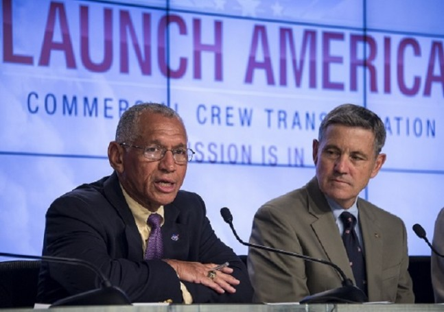 NASA Administrator Charles Bolden, left, announces the agency's selection of Boeing and SpaceX to transport U.S. crews to and from the International Space Station using the Boeing CST-100 and the SpaceX Crew Dragon spacecraft as Former astronaut Bob Cabana, director of NASA's Kennedy Space Center in Florida looks on. Photo Credit: Bill Ingalls/NASA