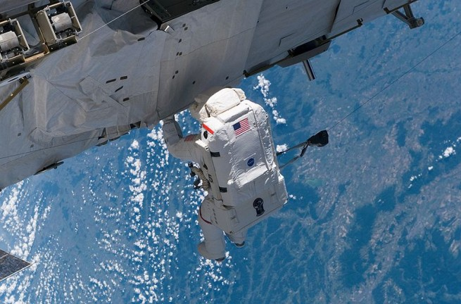 NASA Astronaut Joseph Tanner works on the P3/P4 truss in the first of three EVAs during STS-115. Photo Credit: NASA
