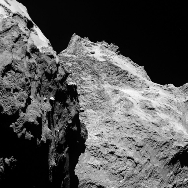 A high-resolution image taken by OSIRIS shows jagged cliffs and prominent boulders on comet 67P. Image Credit: ESA