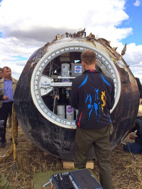The Foton-M4 capsule after landing in Southern Russia on Sept. 1, 2014. Photo Credit: Roscosmos
