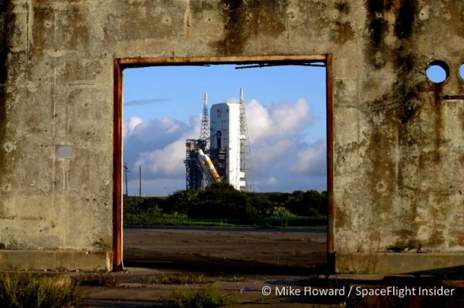 Orion's Delta IV Heavy on the pad, as seen through the adjacent historic Apollo 1 platform. Photo Credit: Mike Howard/Spaceflight Insider