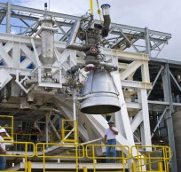 An AJ-26 engine being lowered into the E-1 Test Stand. Photo Credit: NASA