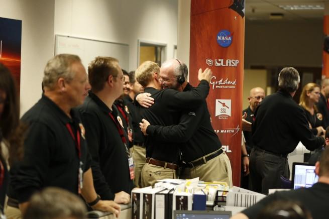 Smiles and applause as MAVEN entered into orbit around Mars Sunday night. Photo Credit: Lockheed Martin